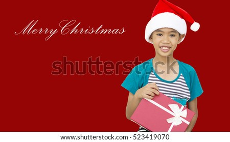 The boy and Christmas gift on the red background