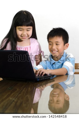 The boy and girl do homework on  laptop - stock photo