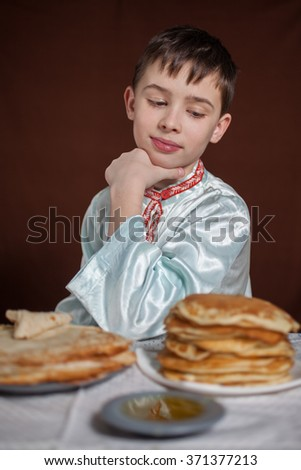 the boy and is a lot of pancakes