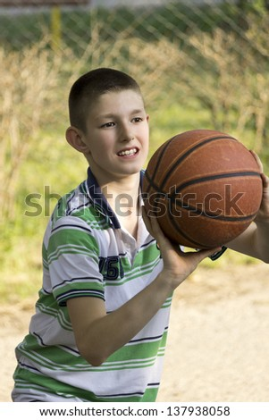 The boy and the basketball - stock photo
