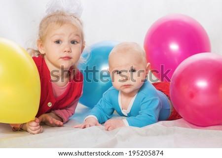 The boy and the girl among balloons - stock photo