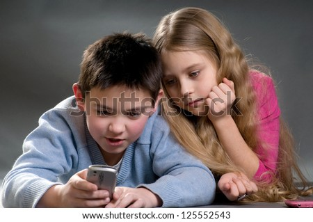 The boy and the girl with phone