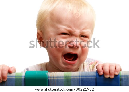 The boy cries of resentment. Isolated on a white background. - stock photo