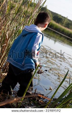 The boy fishing - stock photo
