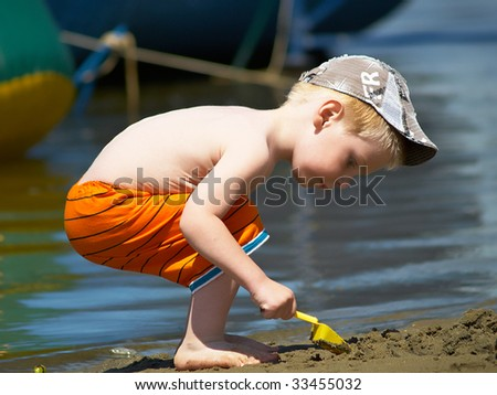 The boy has a rest on the river a sunny day - stock photo