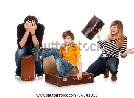 The boy has hidden in a suitcase and has surprised parents - stock photo