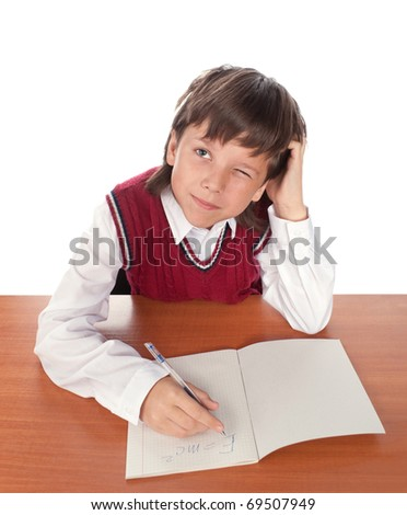 The boy has reflected in a class over an open writing-book - stock photo