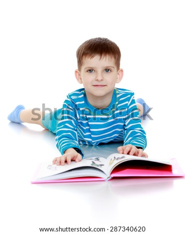 The boy in blue striped t-shirt lying on the floor and reading a book-isolated on white background