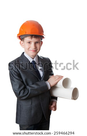 The boy in hardhat holds two sheet of whatman, isolated on white background - stock photo