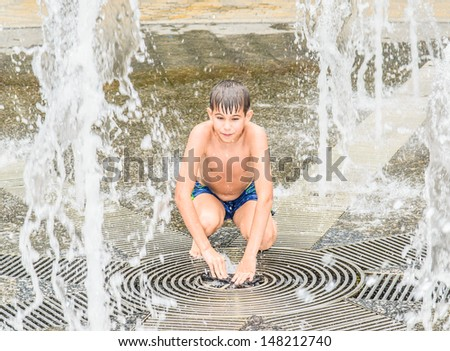 The boy in the fountain. Stock Photo - stock photo