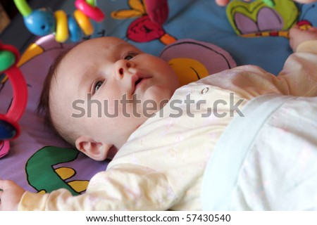 The boy is lying on the bed at home - stock photo