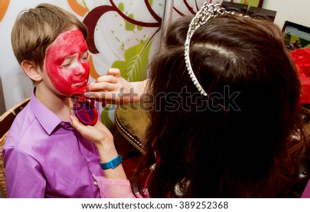 The boy is painted on a children's holiday, the cheerful character - stock photo
