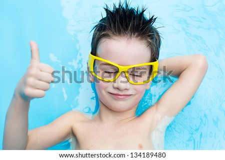 The boy is resting at the water park - stock photo