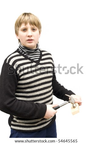 The boy is working with the hammer. Isolation on white background - stock photo