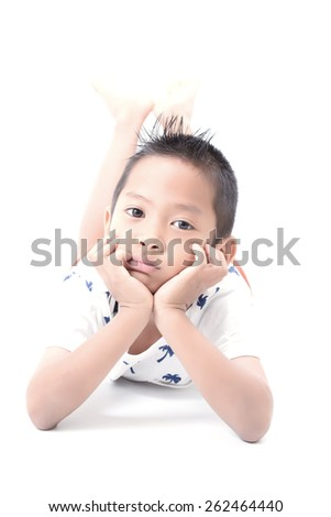 The boy  leisurely laying hands, feet, chin,  isolated white background