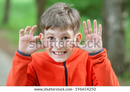 the boy makes a grimace - stock photo