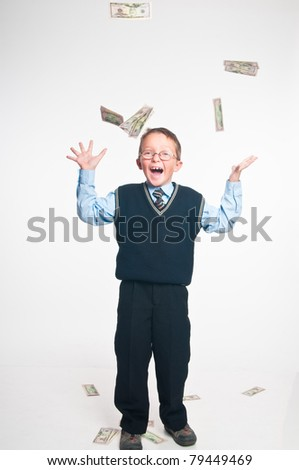 The boy on a white background on which money falls - stock photo