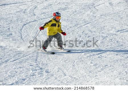 The boy on skis in mountains - stock photo