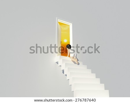 The boy on the stairs near the door. - stock photo