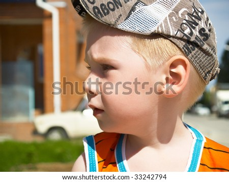 The boy on walk in the summer