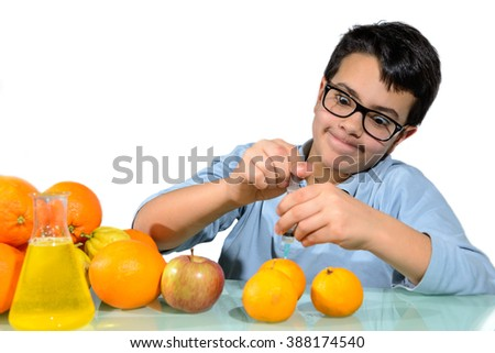 The boy performs experiments with fruit for the lesson of Biology. / Boy Make Experiments with Fruits - stock photo