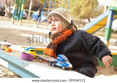The boy plays with toy car - stock photo