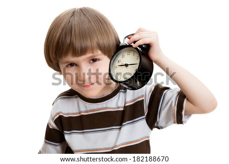 the boy put the clock to your ear - stock photo