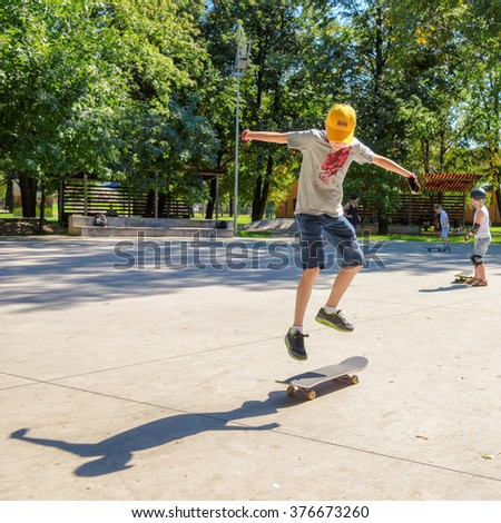 The boy riding on a skateboard and doing exercises jumps - stock photo
