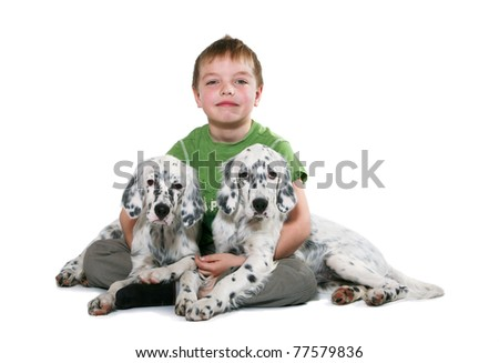 The boy siting with puppy on a white background - stock photo