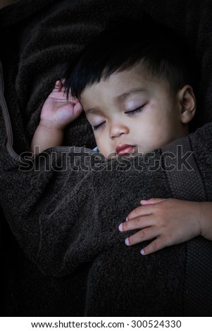 the boy sleeping on soft  blanket