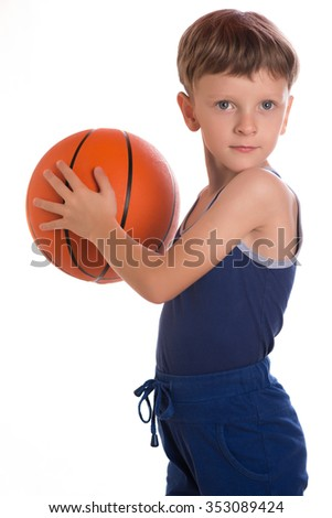 The boy taking a basketball ball in hands to make a throw