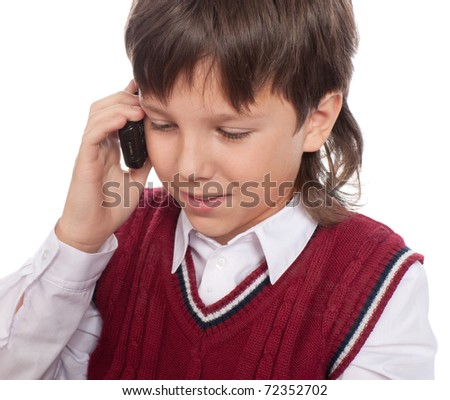 The boy talks on a mobile phone - stock photo
