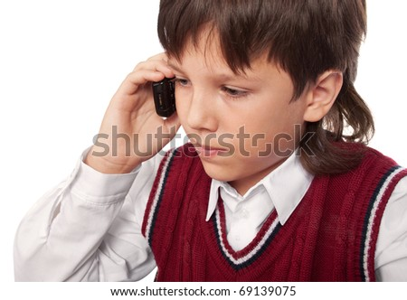 The boy talks on a mobile phone on a white - stock photo
