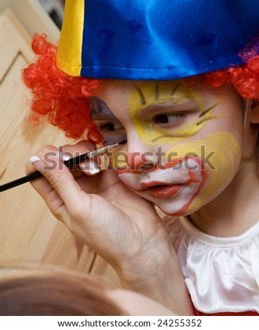 The boy wearing funny clown - stock photo