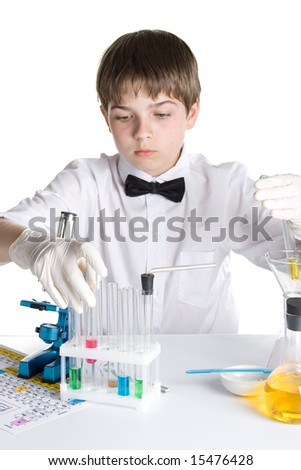 The boy with a microscope and various colorful flasks on a white background