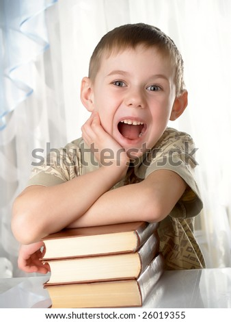 The boy with books on the white background