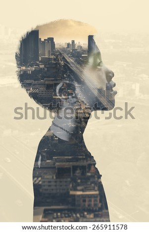 The boy with cityscape background double explosure (Conceptual Surreal Style) - stock photo