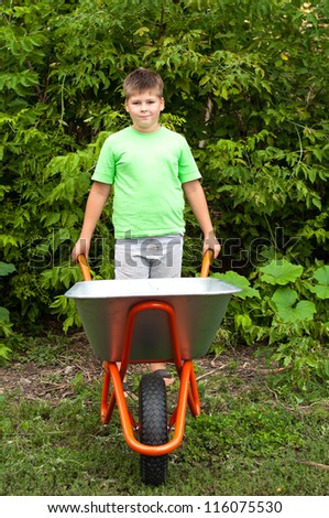 The boy with the empty wheelbarrow