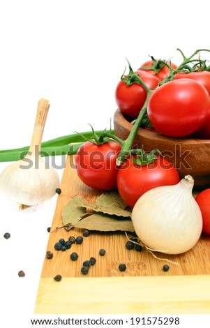The branch of cherry tomatoes in a wooden bowl, isolated on white background