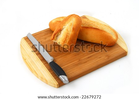 The bread on a chopping board. It is isolated, on a white background