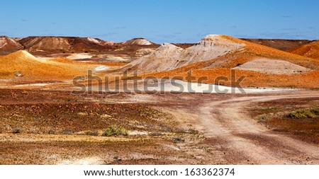 The Breakaways Reserve lies 32km north of Coober Pedy. It consists of colourful low hills which have broken away from the Stuart Range, hence their name Mad Max was filmed here - stock photo