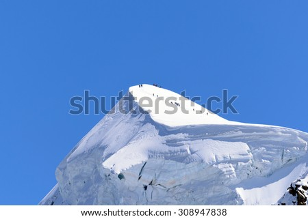 The Breithorn with roped climbers on the summit - 4,165 meters above sea level - stock photo