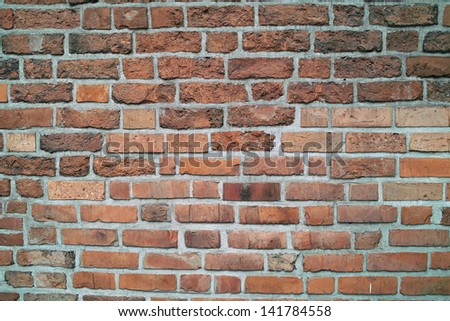 The brick at the red backgroung.