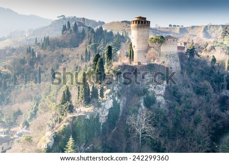 The brick walls of a medieval fortress and a sanctuary devoted to Blessed Virgin on hills in the countryside - stock photo