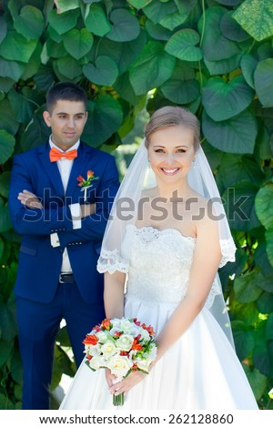The bride and groom at a wedding a walk in the park.happy married couple on nature   - stock photo