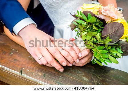 The bride and groom hold each other's hands - stock photo
