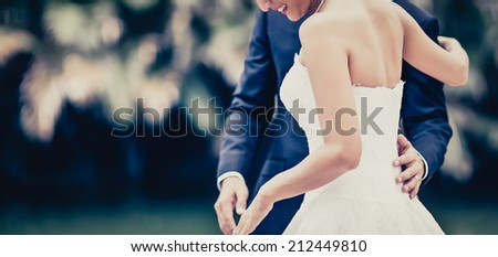 The bride and groom hugging - stock photo