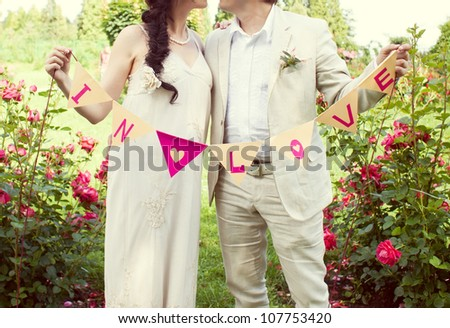 the bride and groom on the nature in love - stock photo