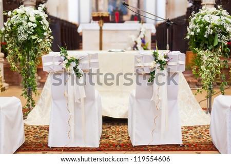 Bride grooms chairs inside church stock photo download now the bride and grooms chairs inside of the church junglespirit Gallery