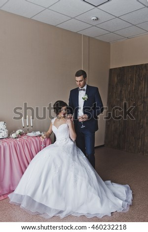 The bride and groom sit at the Banquet table.